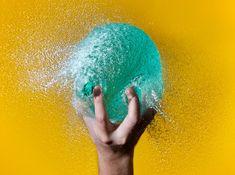 grabbing water balloon
