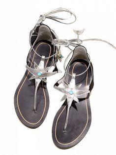Leather look upper Jeweled star embellishment Lace up fastening Toe post design Flat sole Polyurethane
