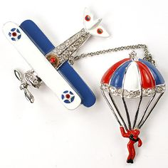 Coro 'Marion Weeber' US Patriotic Red White and Blue Aeroplane and Pilot in Parachute Chatelaine Pins. From trifari.com.