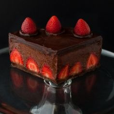 Chocolate Strawberry Mousse Cake - Chocolate cake filled with fresh strawberries and chocolate strawberry mousse and covered in chocolate ganache.