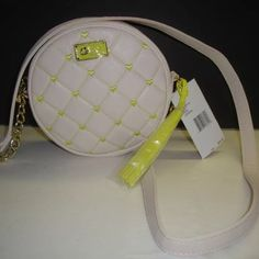 "NWT Betsey Johnson Cream & Yellow Hearts Canteen Style LBTEEN Quilted/embroidered hearts pattern Contrast tassel Gold-tone hardware Zipper closure with lips charm pull Partial chain strap Fabric lining 7"" diameter, 2"" deep 23"" strap drop Betsey Johnson Bags Crossbody Bags"