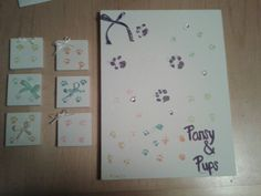 Paw prints with mom and 6 puppies. Little squares go with the puppies when they find their new homes.