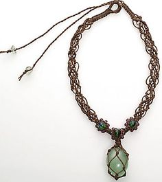 Double strand necklace with centre toggle to adjust length to twin end pendants