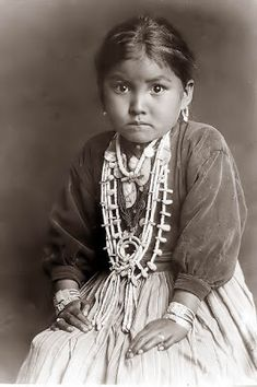 a young Navajo Girl. The girl is wearing a nice array of silver jewelry. The picture was taken in about 1920 near Gallup New Mexico. The gir...
