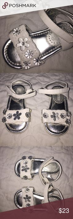 Gorgeous sandals white silver flowers Adjustable Gorgeous sandals white with silver flowers design. Adjustable Velcro at toe area and ankle for perfect fit! Really Cute worn 1x Dress Excellent Condition! Baby girls Size 6. Unlisted Shoes Sandals & Flip Flops