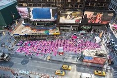 The #firstdayofsummer is just beginning in #TimesSquare. With four more yoga classes to go, #SolsticeTSq welcomes yogis from all over the world to find peace in the heart of #NYC.  #nytsummerday #yoga #yogis #yogaeverywhere