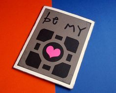 Be my companion cube - grey black and pink blank card - Portal Inspired. $5.00, via Etsy.