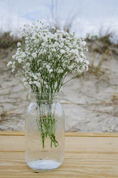 Mason jars as flower vases for Southern wedding decor.