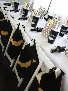 Batman can never have too many sidekicks. Everyone gets a cape with these chair party decorations.