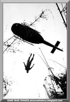 A helicopter lifts the body of a slain US soldier near the Cambodian border