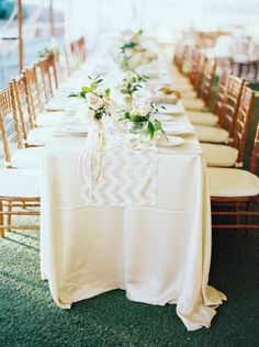 Pretty ivory table with a sequin chevron runner: http://www.stylemepretty.com/2014/06/16/laid-back-glamour-in-charlottesville-virginia/ | Photography: Laura Gordon - http://www.lauragordonphotography.com/
