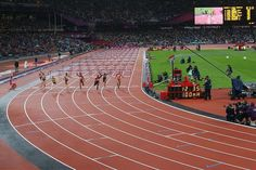 Sally Pearson of Australia crosses the finish line ahead of Dawn Harper and Kellie Wells.  GOLD FOR SALLY!