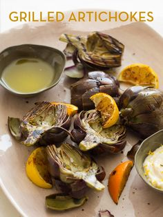 Grilled Artichokes _ Aren't those gorgeous? I love the whole process of eating artichokes. From popping your piece off the stem, to frivolously dipping it into you aioli. I love the way the meat feels on my teeth as I scape it off. If you're lucky, you get a piece with a bit of charr to it. I love the subtle hints of the spices we used. It really makes the artichoke sing against the sting of the aioli. Enjoy!