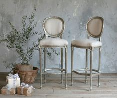 Reproduction Louis XVI Style bar stools in lovely worn silver leaf finish