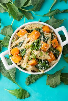 Tender penne pasta tossed with fresh pesto, roasted butternut squash, baby kale, and parmesan cheese. This dish is uber easy and full of flavor!