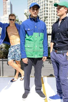 Cole Wingo poses in a parrot green/blue colorblock cotton canvas parka, parrot green cotton piered shirt, and compass blue cotton dobby stripe pant from the Nautica Men's Spring 2013 collection by Chris Cox, during New York Fashion Week Spring 2013, September 7, 2012.