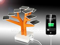 The USB Solar Charger Tree comes with a set of solar panels held by a tree like structure that stands on a base containing the rechargeable batteries and USB ports.
