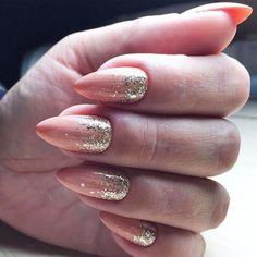 Classy Nude Nails With Gold Glitter Ombre #glitternails #goldglitter Nude nails are trendy these days. Discover classy and simple nail  designs in nude shades. This nail art is the real beauty. #nudenails  #nailsdesign #nailart #nails
