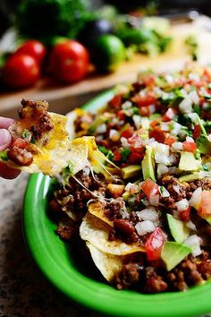 Loaded Nachos by pioneer woman.   We made these for dinner and they are awesome!!!!!!! :)