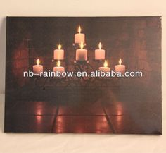 led candle canvas flickering wall painting  This dramatic photo of burning candles contains eight LED lights embedded inside.