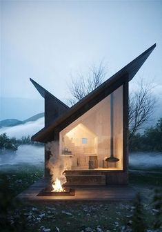 I love how the lines of the roof meet to make a house shape inside. Carpineto Mountain Refuge near Italy, concept design by Architect Massimo Gnocchi Tiny House Cabin, Tiny House Living, Cozy House, Cozy Cabin, Living Room, Casas Containers, Cabin In The Woods, Cabana, Exterior Design