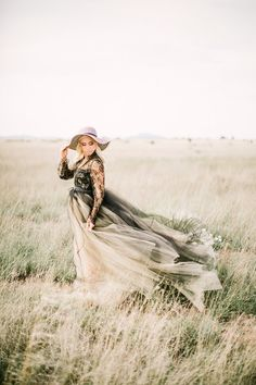 Black wedding dress | Leighanne Herr | see more on: http://burnettsboards.com/2015/09/black-gold-wedding-inspiration-rugged-west-texas/