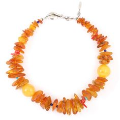 Amber, turquoise, lapis lazuli, and red coral necklace by Steinen