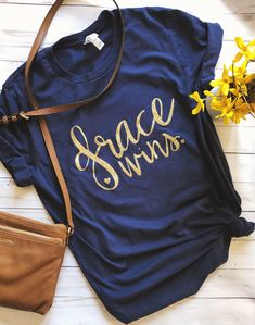 ed71908be73d G R A C E W I N S - every time - Wear this beautiful shirt to show your  love for God's grace. It is made with gold glitter and will be sure to  stand out.