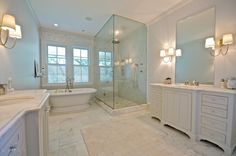 I like the floor and vanity tops in this, plus the pale hint of color in the glass shower area.