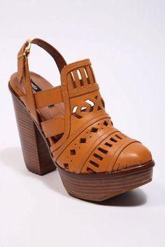 Miista Tan Cut-Out Platform Heels.