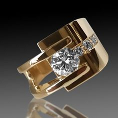 yellow gold channel set diamond ring with split shank and accent diamonds on side