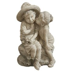 Though it may look like a quick peck on the cheek to the passerby, this first time kiss is what childhood memories are made of! From wide brimmed straw hat to dimpled cheeks, Playful child sculpture is fraught with detail. Design Toscano-exclusive is cast in quality designer resin with a faux stone finish. At just over a foot tall, this child statue art adapts beautifully to home or garden and makes a most nostalgic gift!