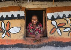 https://flic.kr/p/UzS6s5 | Ethiopian woman standing in the window of her traditional painted house, Kembata, Alaba Kuito, Ethiopia | © Eric Lafforgue www.ericlafforgue.com