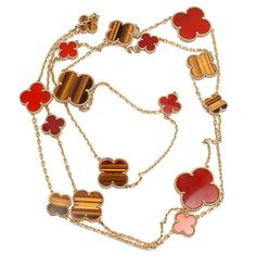 VAN CLEEF & ARPELS Magic Alhambra Carnelian Tiger-Eye Necklace | From a unique collection of vintage drop necklaces at http://www.1stdibs.com/jewelry/necklaces/drop-necklaces/  21k USD