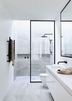 "Dipt Box ""Minimalist Bathroom"" by Sample Dipt Design by Canny Homes Contemporary Minimalism at its finest–steel enclosed marble shower is all you really need. Powder Coated steel frames around the minimal shower glass wall, emphasize the height in the otherwise slender space. A light grey marb"