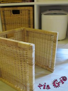 Cut the bottom and side off an IKEA Branas basket to hide a bigger object inside a Hemnes unit.