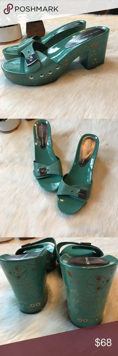 "Marc by Marc Jacobs sodden platform sandals Super fun teal sandals with carved wood platform. 3.5"" heel, 1.5"" platform in front. In gently used condition with one tiny mark on toe bed of right foot). Carved designs in platform. Size 37 euro size Marc by Marc Jacobs Shoes Platforms"
