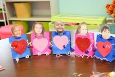 Making Valentine Boxes (Bags) for Valentine's Day deliveries! Uses gift bag, Hearts, Pipe cleaners, and pompoms. Fun things from the @Target Dollar section! Great Fine Motor activity and Valentine's activity.