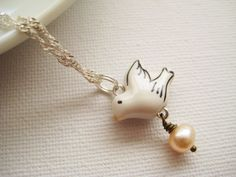 Sterling silver necklace with porcelain dove and freshwater