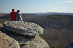 couple sitting on rocks in the garden of the gods Illinois state park