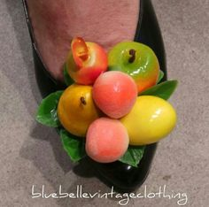 The fruit salad shoe clips on a pair of vintage black shoes