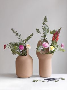 Natural terracotta colored vases in a contemporary silhouette by Jaime Hayon of Hayon Studio for BD Barcelona.
