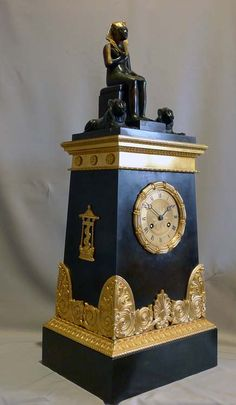 Antique Egyptian Revival restoration mantel clock signed Picnot Pere a Paris.