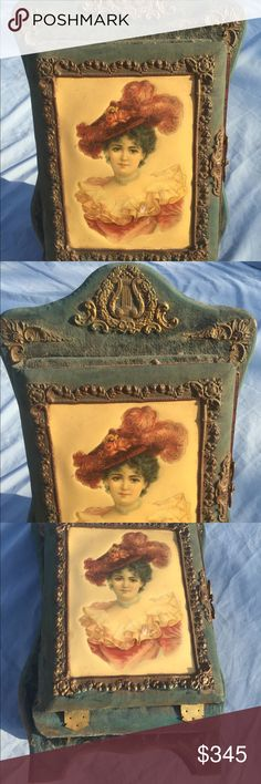 Antique Victorian Crushed Velvet Photo Album Stand Antique Victorian Crushed Velvet Photo Album On Stand. Porcelain portrait of late victorian gibson girl. Very unique shape and gold hinges as well as gold decorative appliqués.  Some very old photos in album. Approx 20 inches tall. Very unique and rare piece! Vintage Other