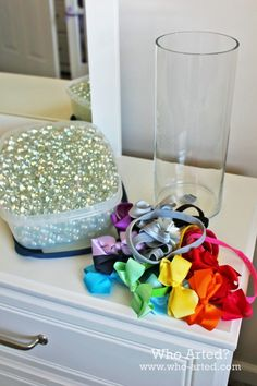 Easy and fashionable way to display headbands - glass jar with pearls or diamonds inside