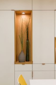 A close-up look at an open shelf positioned within cabinetry, perfect for displaying vases and artwork.