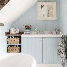 Pale blue country bathroom with wooden panelling Country Blue Bathrooms, Seaside Bathroom, Beach House Bathroom, Loft Bathroom, Wooden Bathroom, Upstairs Bathrooms, Small Bathrooms, Bathroom Storage, Bathroom Interior