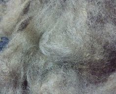 1oz washed wool natural colored. Tan grey cream black.