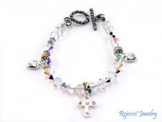 """30% OFF SALE """"Love at the Cross""""  This beautiful 7 1/2 inch reflective Swarovski crystals bracelet with silver charms represents what He did for us. Original price $59 SALE! $42 www.rejoicejewelry.com"""