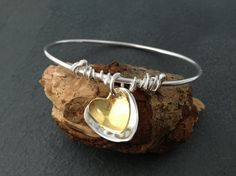 sterling silver bangle with heart charms with by silvermeadows, £60.00
